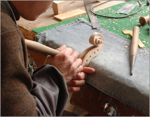 Finishing the pegbox on a violin